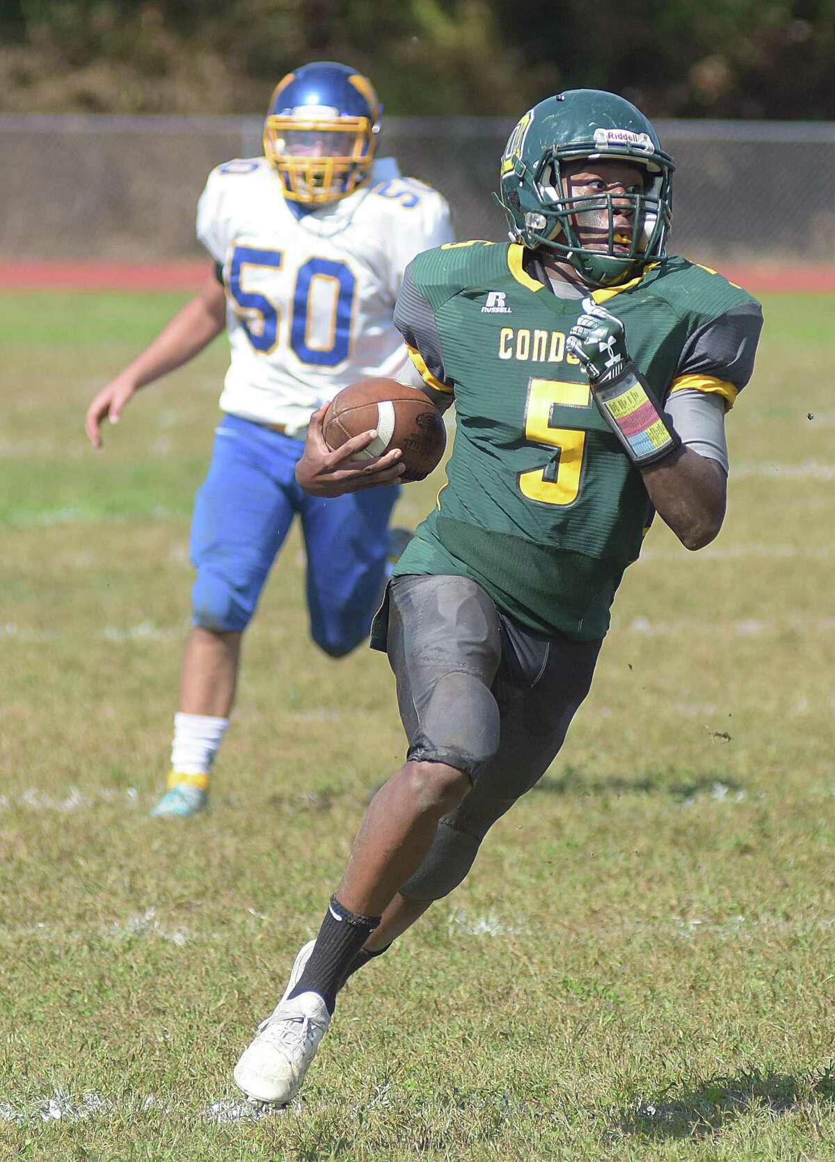 O?'Brien Tech?'s Jonte Roc (5) runs away from the defense during Saturday?'s high school football game against Wilcox Tech in Ansonia.