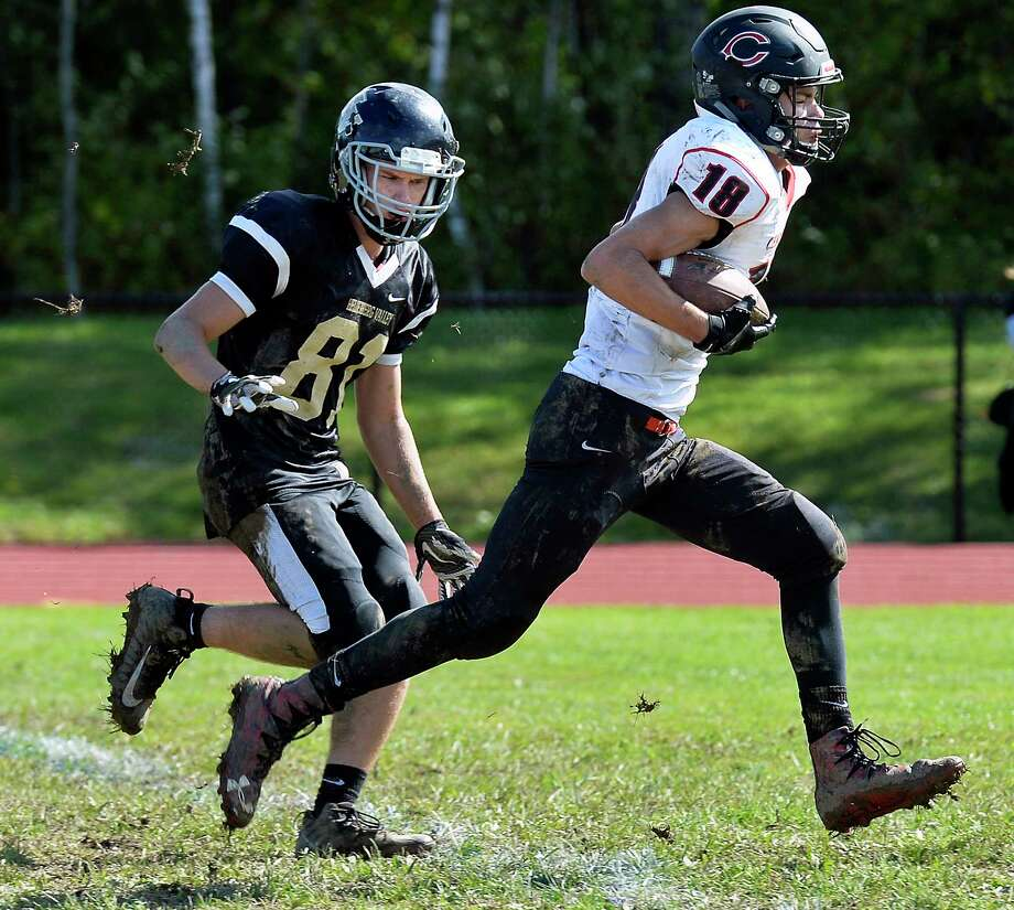 Helderberg Valley's #81 Jake Stahl, left, watches as Chatham's #18 Hunter Scheriff crosses the goal line to score during Saturday's game Sept. 29, 2018 in Delanson, NY.  (John Carl D'Annibale/Times Union) Photo: John Carl D'Annibale, Albany Times Union / 20044923A
