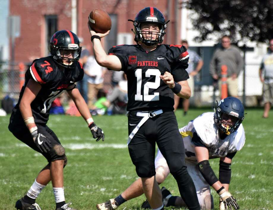 Cromwell/Portland quarterback Bryce Karstetter throws against Haddam-Killingworth on Saturday. Photo: Pete Paguaga / Hearst Connecticut Media