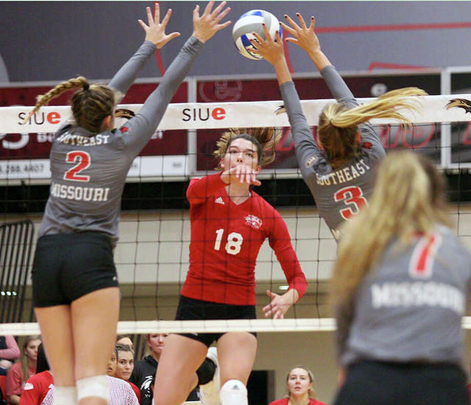 SEMO's Annie Wehrheim (2) and Maggie Adams (3) go up for a block against SIUE's Annie Ellis (18) in action Saturday at the Vadalabene Center. Photo: SIUE Athletics