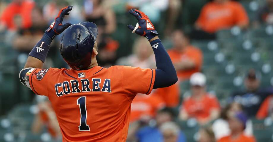 BALTIMORE, MD - SEPTEMBER 29: Carlos Correa #1 of the Houston Astros celebrates after hitting a solo home run in the sixth inning against the Baltimore Orioles during Game One of a doubleheader at Oriole Park at Camden Yards on September 29, 2018 in Baltimore, Maryland. (Photo by Patrick McDermott/Getty Images) Photo: Patrick McDermott/Getty Images