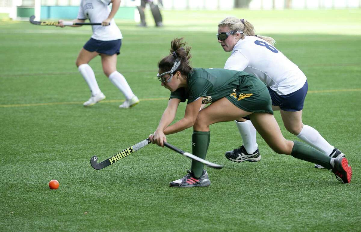Hotchkiss' Kiernan McColgan and Greenwich Academy's Katharine Glassmeyer compete for control of the ball during Saturday's field hockey game at Greenwich Academy in Greenwich, Conn.