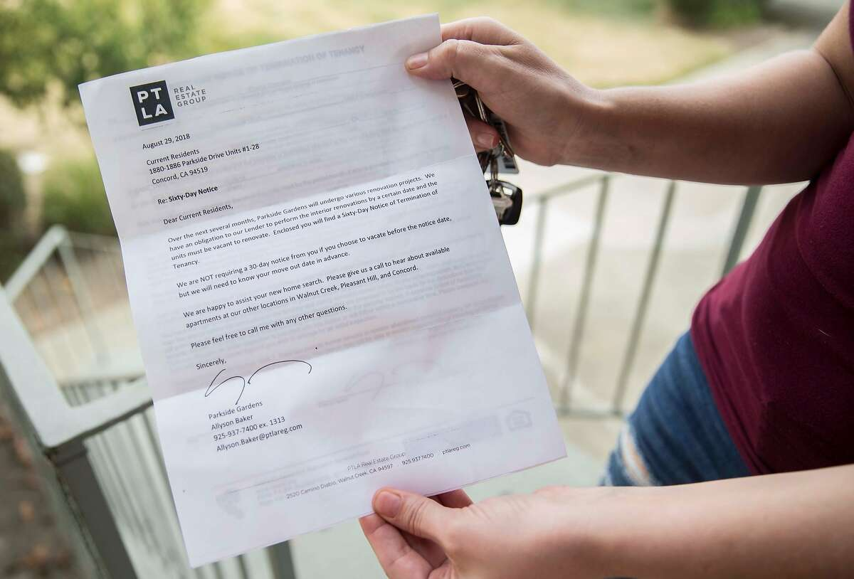 Crystal Chandler shows the eviction notice she was given one month ago while standing outside of her apartment in Concord, Calif. Saturday, Sept. 29, 2018.