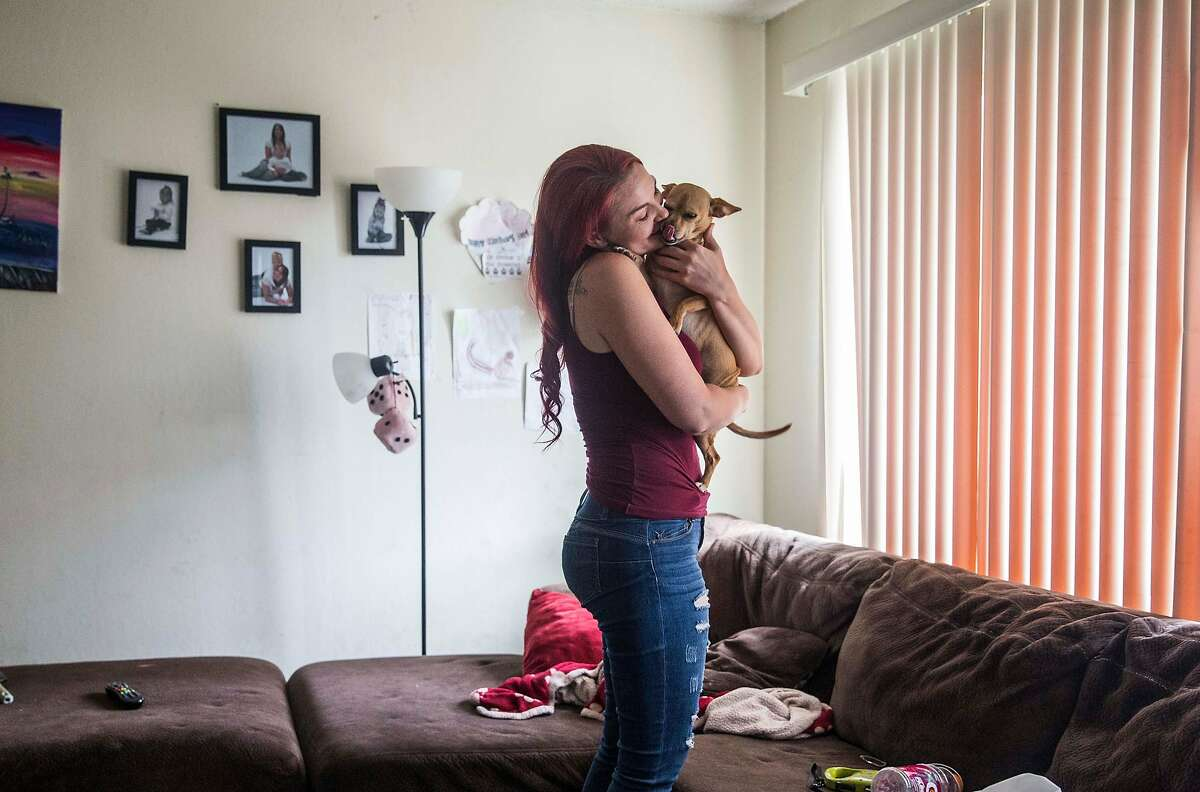 Crystal Chandler greets her dog, Precious, after arriving at her apartment in Concord, Calif. Saturday, Sept. 29, 2018.