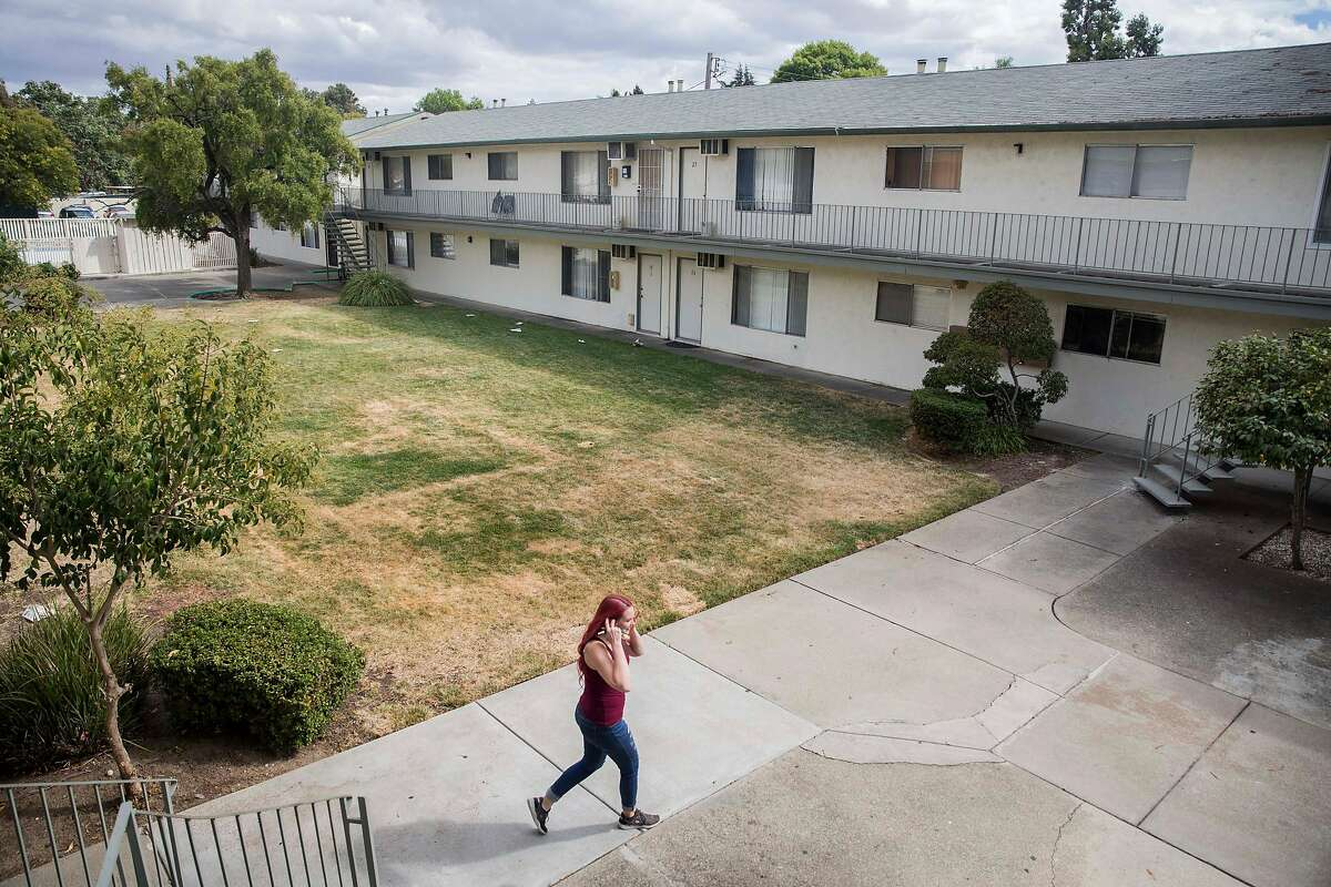 Crystal Chandler walks to her car from her apartment in Concord, Calif. Saturday, Sept. 29, 2018.