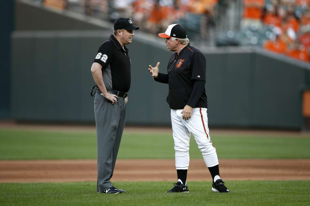 Baltimore Orioles manager Buck Showalter, right, protests a call to umpire Chad Whitson in the sixth inning of the first baseball game of a doubleheader between the Orioles and the Houston Astros, Saturday, Sept. 29, 2018, in Baltimore. (AP Photo/Patrick Semansky)