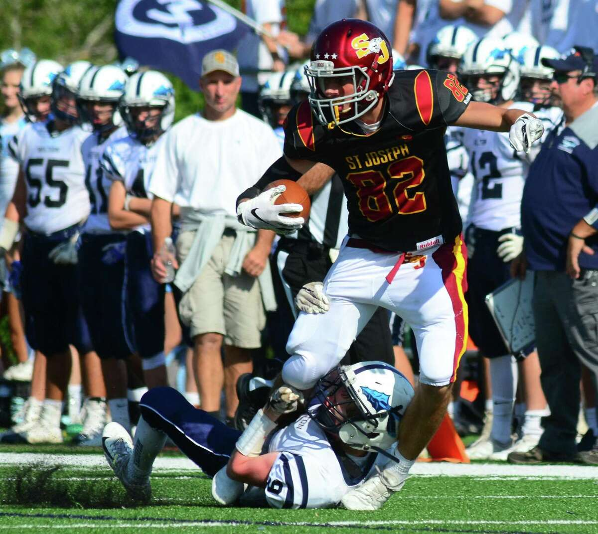 St. Joseph's William Diamantis (8) is tackled by Wilton's Thomas Costello during Saturday's game in Trumbull.