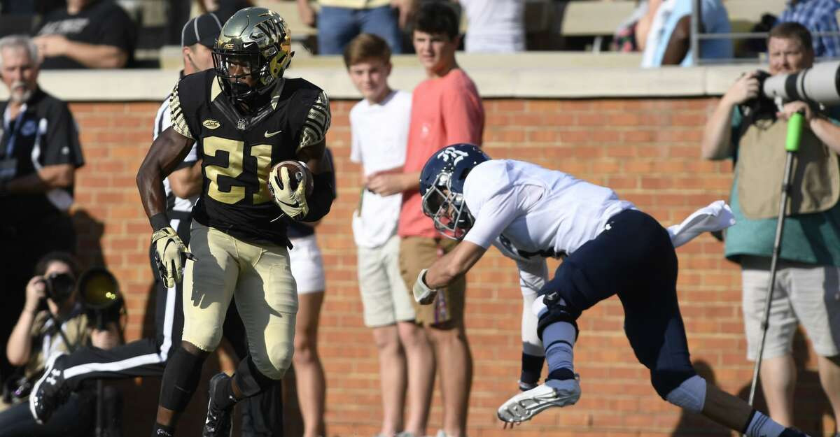 Wake Forest's Essang Bassey (21) makes a 51 yard fumble recovery for a touchdown during the first half of their NCAA college football game against Rice, Saturday, Sept. 29, 2018, in Winston-Salem, N.C. (AP Photo/Woody Marshall)