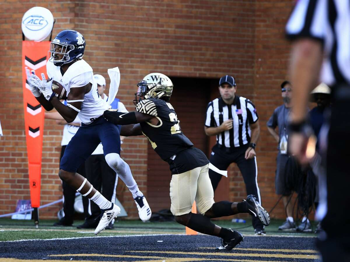 Rice's Aaron Cephus (28) makes a touchdown reception as Wake Forest's Essang Bassey (21) defends during the second half of their NCAA college football game, Saturday, Sept. 29, 2018, in Winston-Salem, N.C. Wake Forest defeated Rice 56-24. (AP Photo/Woody Marshall)