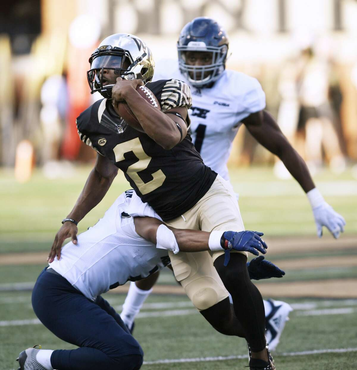 Wake Forest's wide receiver Kendall Hinton (2) is tackled by Rice's Brandon Douglas-Dotson (3) during the second half of their NCAA college football game, Saturday, Sept. 29, 2018, in Winston-Salem, N.C. (AP Photo/Woody Marshall)