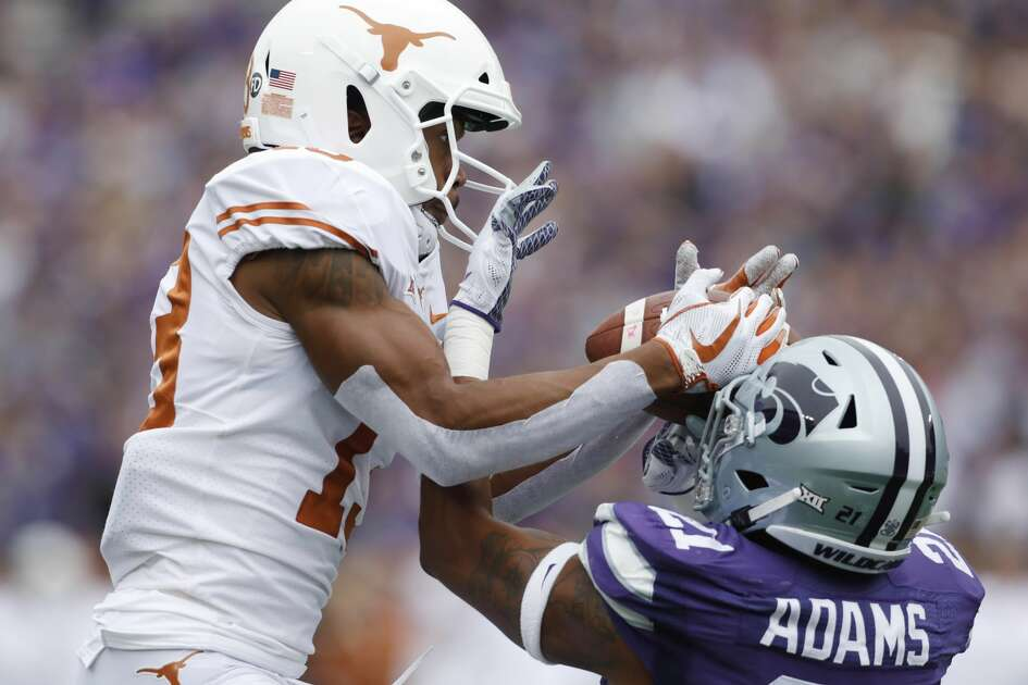 Texas wide receiver Jerrod Heard (13) is unable to catch a pass in the end zone as Kansas State safety Kendall Adams (21) defends during the first quarter of a college football game in Manhattan, Kan., Saturday, Sept. 29, 2018. (AP Photo/Colin E. Braley)
