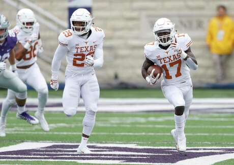 Texas' D'Shawn Jamison, right, returns a Kansas State punt 90 yards for a touchdown as Josh Thompson deploys as his wingman during the first quarter Saturday.