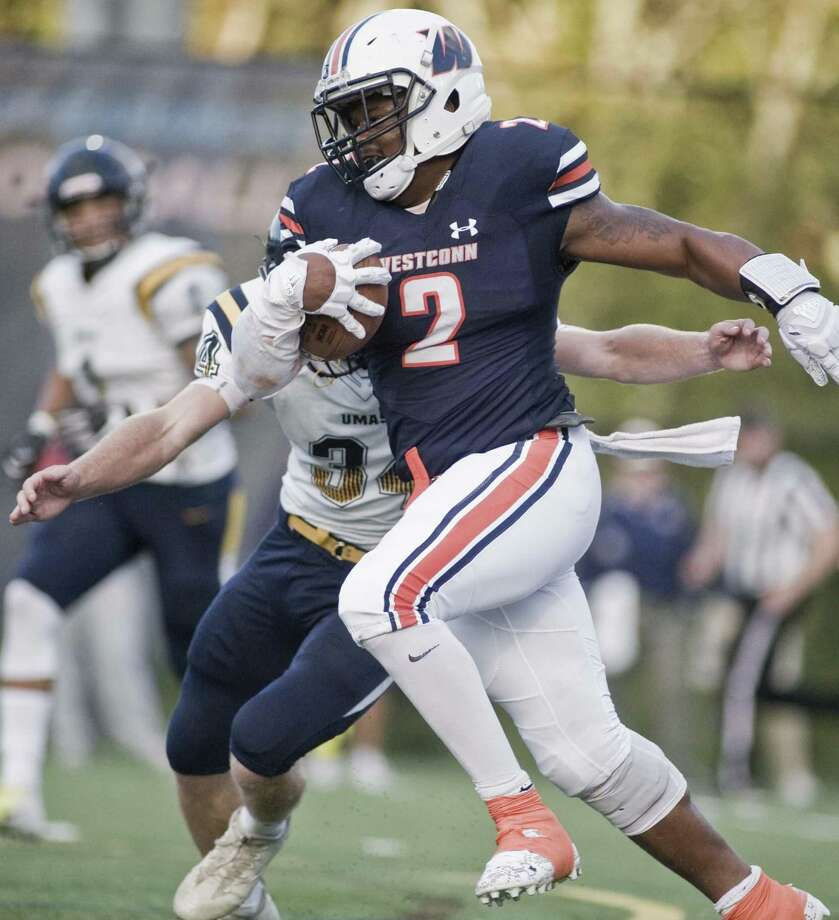 WestConn's Kyle McKinnon carries the ball in a game against UMass-Dartmouth, played at WestConn. Saturday, Sept. 29, 2018 Photo: Scott Mullin / For Hearst Connecticut Media / The News-Times Freelance