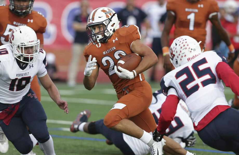 Maverick running back Christian Hernandez finds a seam and sprints in for the Maverick's first touchdown as Madison plays Roosevelt at Heroes Stadium on September 29, 2018. Photo: Tom Reel, Staff / Staff Photographer / 2017 SAN ANTONIO EXPRESS-NEWS