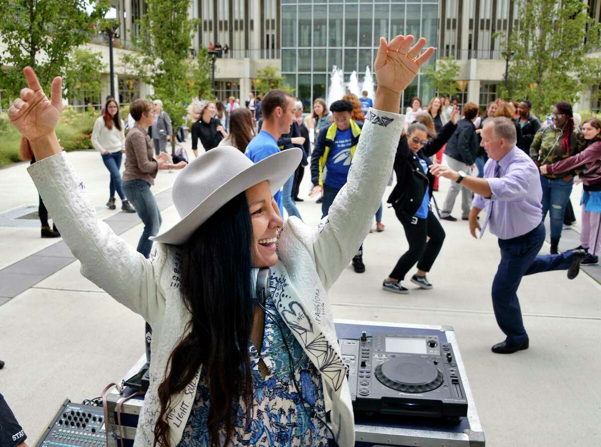 Radha Agrawl of Brooklyn, author and founder of Daybreaker leads a morning dance party as UAlbany hosts the Albany Book Festival Saturday Sept. 29, 2018 in Albany, NY. (John Carl D'Annibale/Times Union)