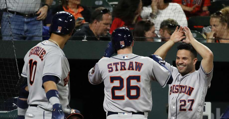 BALTIMORE, MD - SEPTEMBER 29: Myles Straw #26 of the Houston Astros celebrates with teammate Jose Altuve #27 after hitting a solo home run in the first inning against the Baltimore Orioles during Game Two of a doubleheader  at Oriole Park at Camden Yards on September 29, 2018 in Baltimore, Maryland. (Photo by Patrick McDermott/Getty Images) Photo: Patrick McDermott/Getty Images