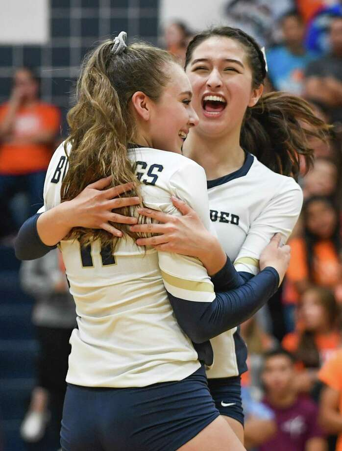 Alexander High School during Kayra Guajardo and Anali Santos celebrate a point during a game against United High School on Saturday, Sept. 29, 2018, at Alexander High School. Photo: Danny Zaragoza / Laredo Morning Times