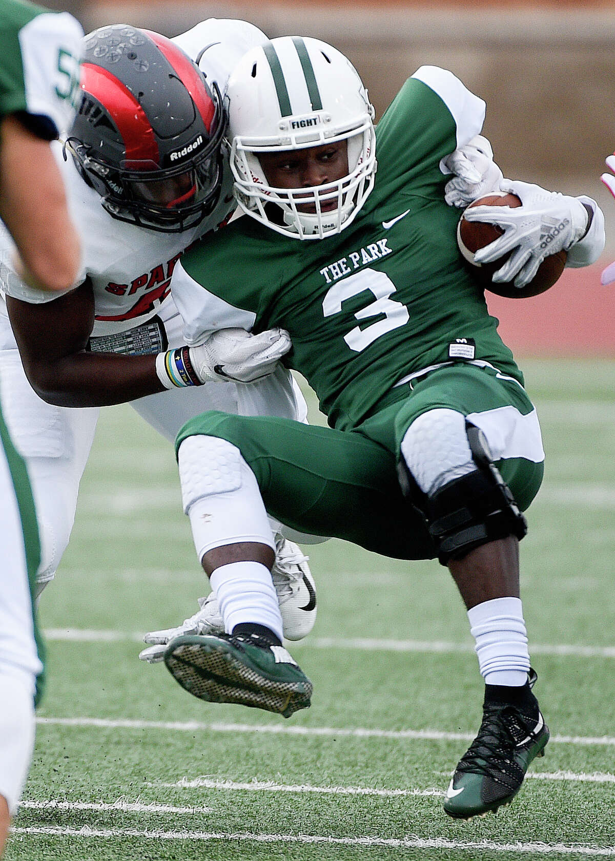 Kingwood Park wide receiver Dylan Johnson, right, is tackled by Porter linebacker Zhyon Bell during the first half of a high school football game, Saturday, Sept. 29, 2018, in Humble, TX. (Eric Christian Smith/Contributor)