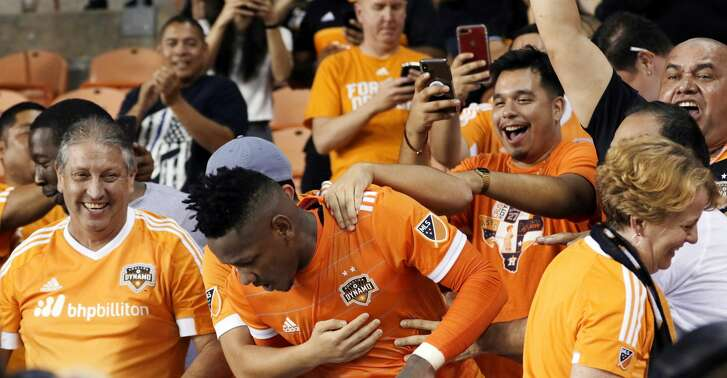 Houston Dynamo forward Romell Quioto is swarmed by fans after he jumped into the stands after scoring the winning goal against the San Jose Earthquakes during the second half of their MLS game at BBVA Compass Stadium Saturday, Sep. 29, 2018 in Houston, TX.