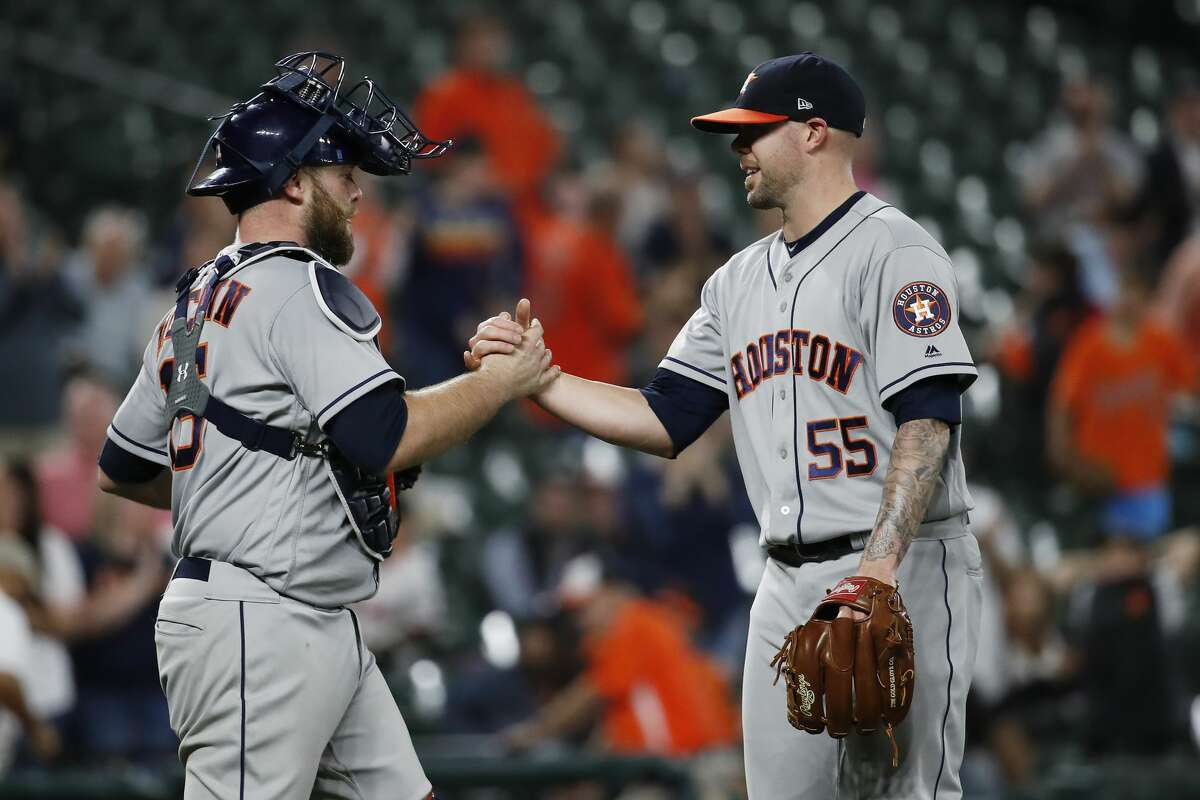 BALTIMORE, MD - SEPTEMBER 29: Ryan Pressly #55 and Brian McCann #16 of the Houston Astros celebrate after the Astros defeated the Baltimore Orioles 5-2 during Game Two of a doubleheader at Oriole Park at Camden Yards on September 29, 2018 in Baltimore, Maryland. (Photo by Patrick McDermott/Getty Images)
