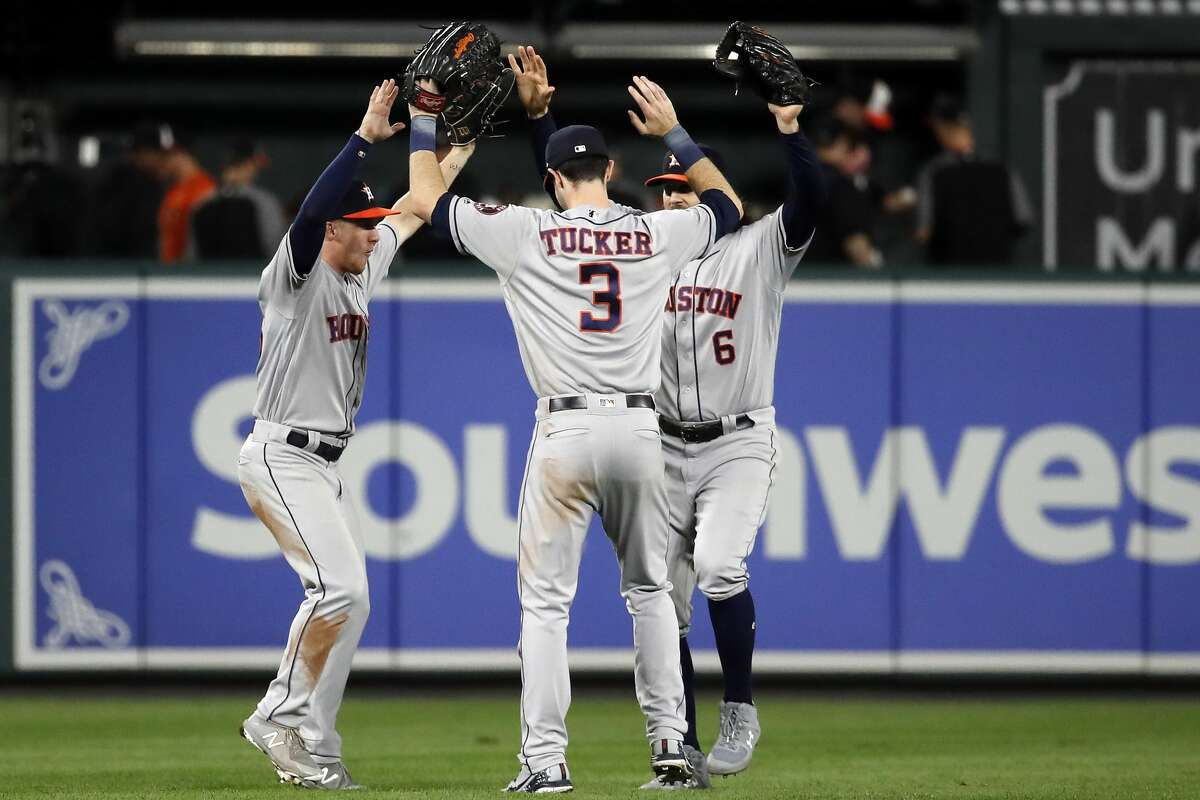 BALTIMORE, MD - SEPTEMBER 29: Myles Straw #26, Kyle Tucker #3, and Jake Marisnick #6 of the Houston Astros celebrate after the Astros defeated the Baltimore Orioles 5-2 during Game Two of a doubleheader at Oriole Park at Camden Yards on September 29, 2018 in Baltimore, Maryland. (Photo by Patrick McDermott/Getty Images)