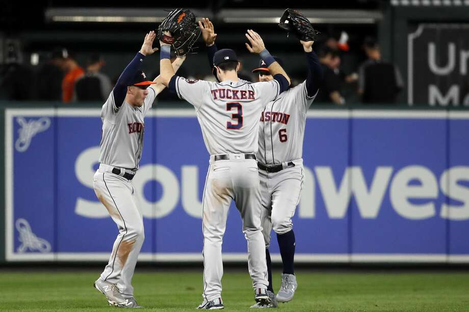 BALTIMORE, MD - SEPTEMBER 29: Myles Straw #26, Kyle Tucker #3, and Jake Marisnick #6 of the Houston Astros celebrate after the Astros defeated the Baltimore Orioles 5-2 during Game Two of a doubleheader  at Oriole Park at Camden Yards on September 29, 2018 in Baltimore, Maryland. (Photo by Patrick McDermott/Getty Images) Photo: Patrick McDermott/Getty Images
