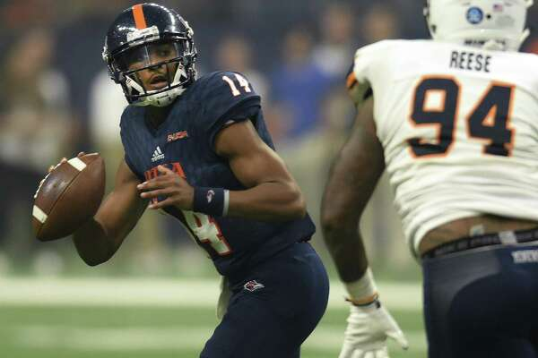 UTSA quarterback Cordale Grundy looks for an open receiver as CJ Reese of UTEP chases him down during college football action in the Alamodome on Saturday, Sept. 29 2018.