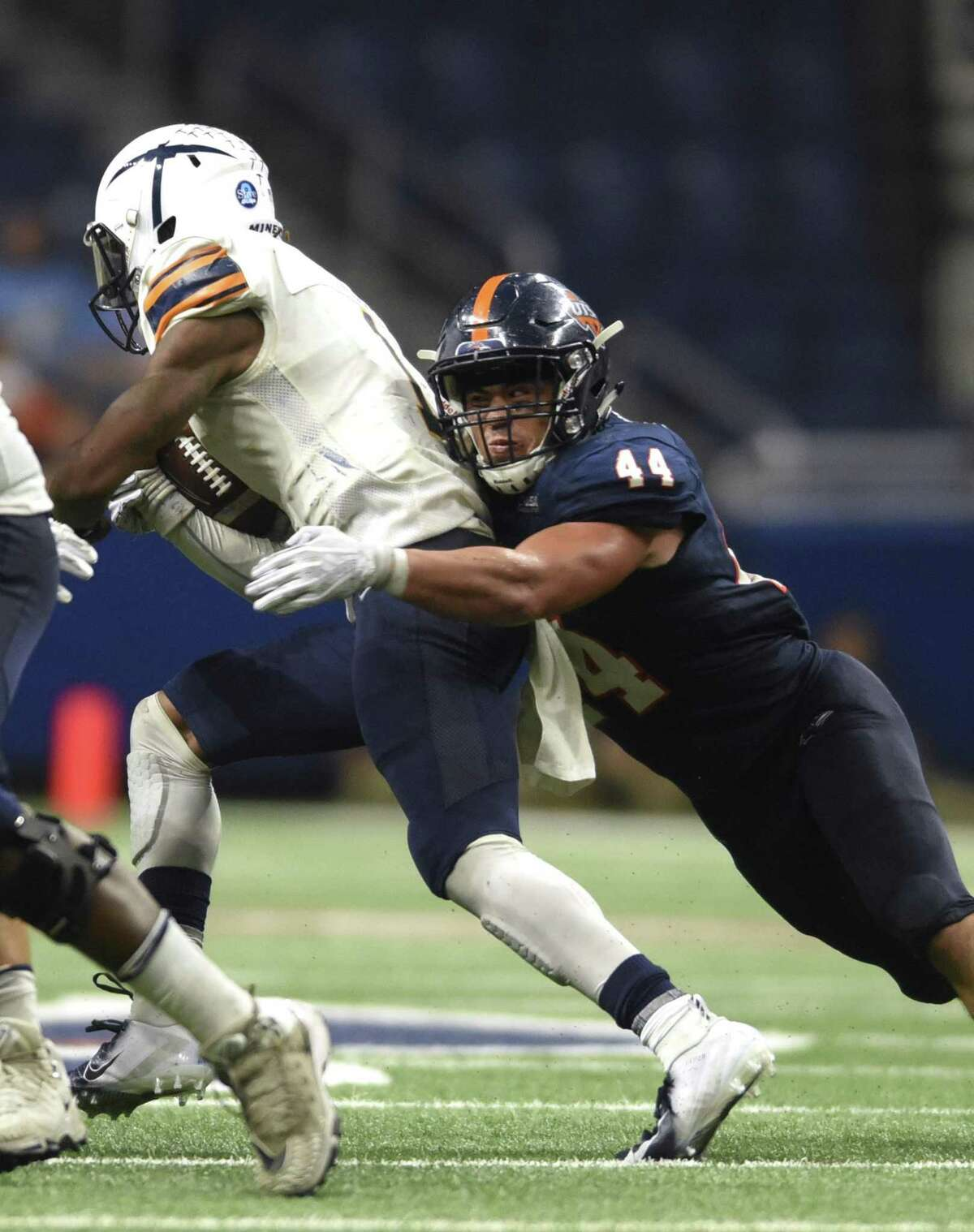 UTEP's Treyvon Hughes is taken down by UTSA's linebacker Les Maruo during second-half college football action in the Alamodome on Saturday, Sept. 29 2018.