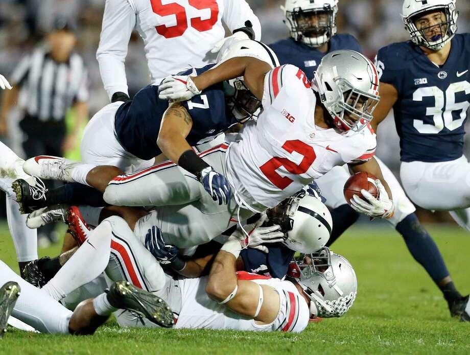 6dc983086 Ohio State s J.K. Dobbins (2) is tackled by Penn State s Koa Farmer (7