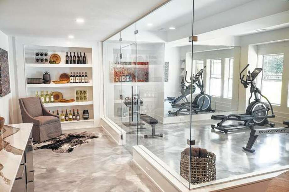 This 6,000-square-foot Romanelli & Hughes home designed for the BIA Parade of Homes in Columbus, Ohio, features deep window wells, a glass-enclosed fitness center and glass doors in the basement to increase the amount of natural light in the home. Photo: John Evans   BIA Of Central Ohio Parade Of Homes Via AP