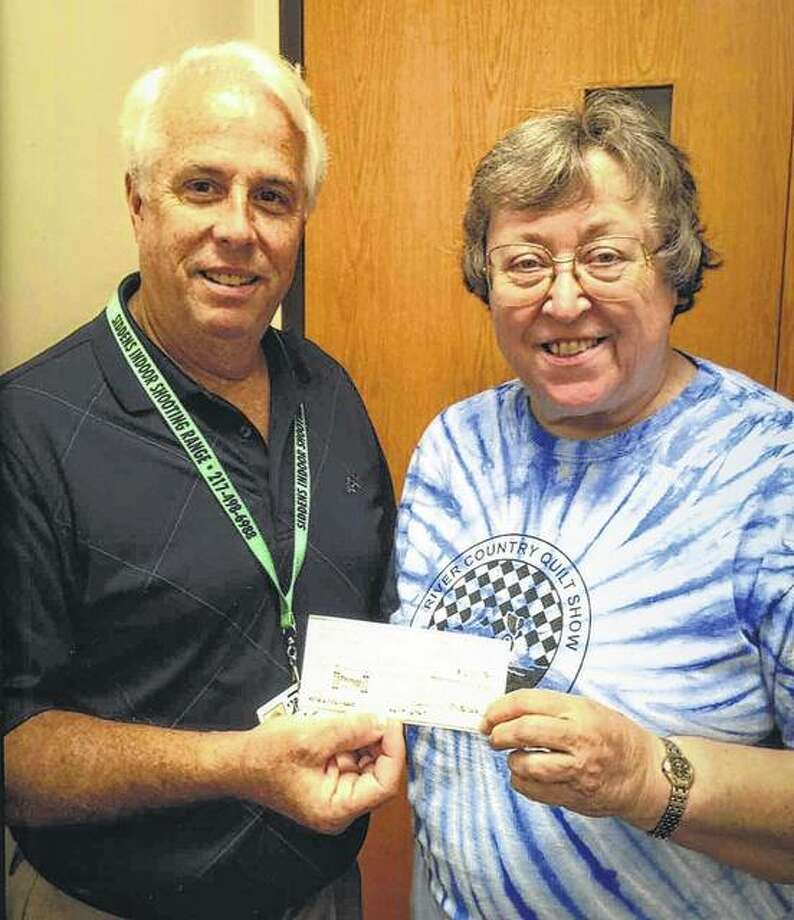 Barbara Suelter, representing the River Country Quilt Show, presents a check to Pathway Services Unlimited Executive Director Steve Brundage. Proceeds from the quilt show will help cover the cost of some of the unfunded needs of Pathway clients. Photo: Photo Provided