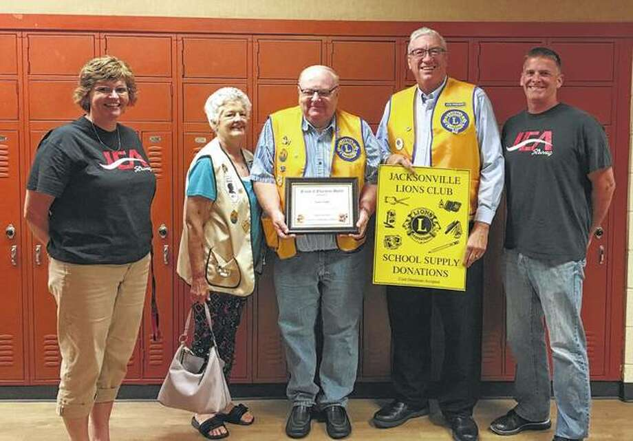 Jacksonville Education Association recently recognized the Jacksonville Lions Club for its efforts on behalf of Jacksonville students, presenting club representatives with JEA's Friends of Education Award. Lions Club members collect school supplies for students ahead of each school year and distribute collected supplies to each school so every student has the right tools to start the year. Photo: Photo Provided
