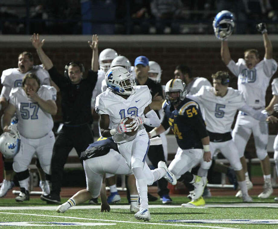 Illinois College's Glen Gibbons returns a punt 73 yards for a touchdown during a game againts Beloit in Jacksonville Saturday night.