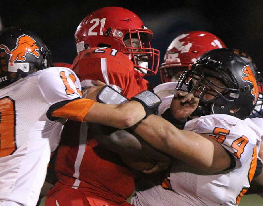 Jacksonville's Chris Pulley pushes forward during a game against Lanphier Friday night. Photo: Dennis Mathes | Journal-Courier
