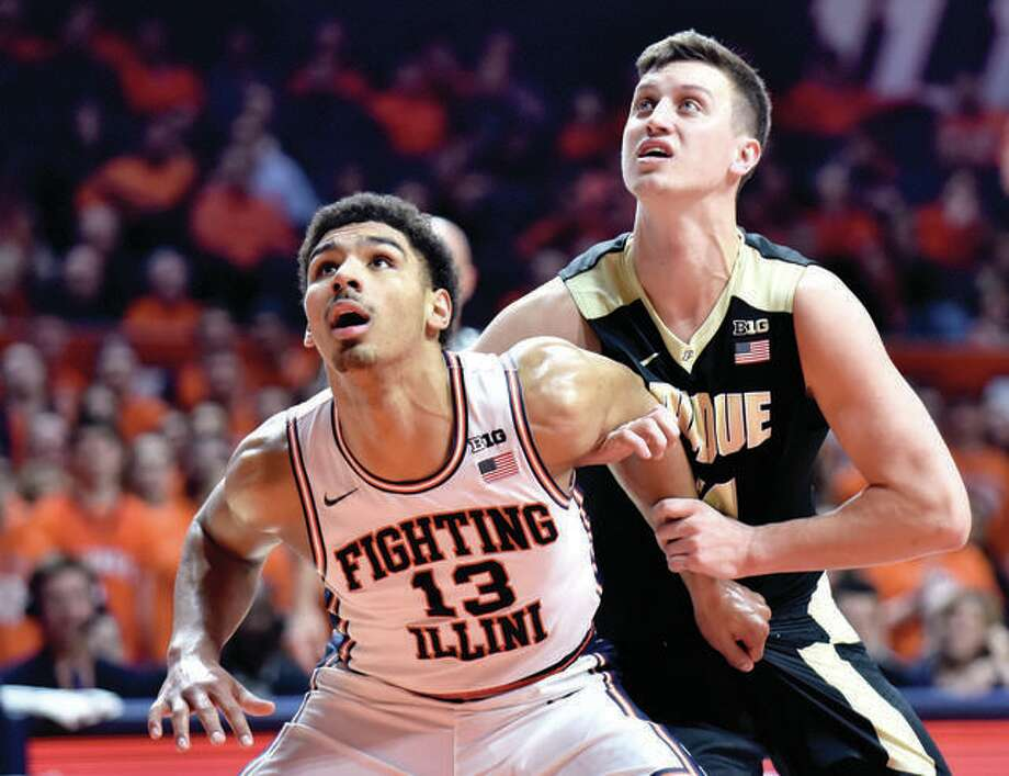 Former Edwardsville High star Mark Smith (13) battles for a rebound a freshman starters last season against Purdue's Grady Eifert. Smith was later relegated to the bench for various reasons and has since transferred to Missouri. Photo: AP