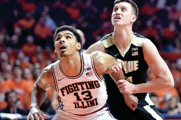 Former Edwardsville High star Mark Smith (13) battles for a rebound a freshman starters last season against Purdue's Grady Eifert. Smith was later relegated to the bench for various reasons and has since transferred to Missouri.