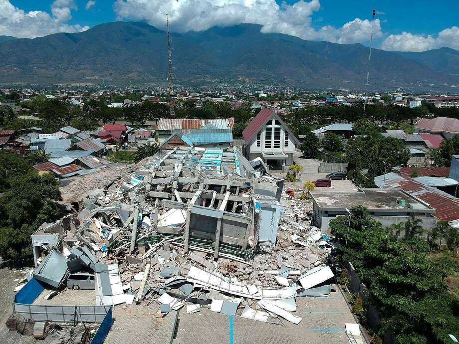 TOPSHOT - This aerial picture shows the remains of a ten-storey hotel in Palu in Indonesia's Central Sulawesi on September 30, 2018 after it collapsed following a strong earthquake in the area. - The death toll from the powerful earthquake and tsunami in Indonesia rose to 420 on September 30, as stunned people on the stricken island of Sulawesi struggled to find food and water, looting spread and fears grew that whole towns had still not been heard from. (Photo by Azwar / AFP)AZWAR/AFP/Getty Images Photo: AZWAR, AFP/Getty Images