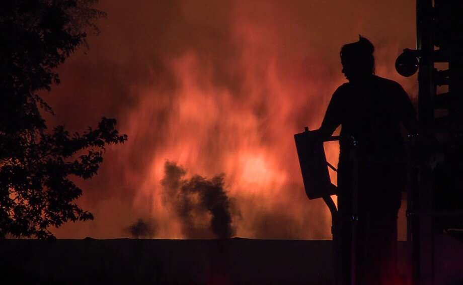 San Antonio firefighters tackled fire early Sunday, Sept. 30, 2018, at a vacant commercial building. The building was deemed a total loss. Photo: J.J. Trevino / 21 Pro Video