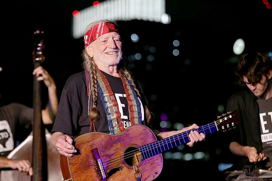 Texas icon Willie Nelson is on the road again and will make a stop in San Antonio this winter to perform two shows. Photo: Gary Miller/Getty Images