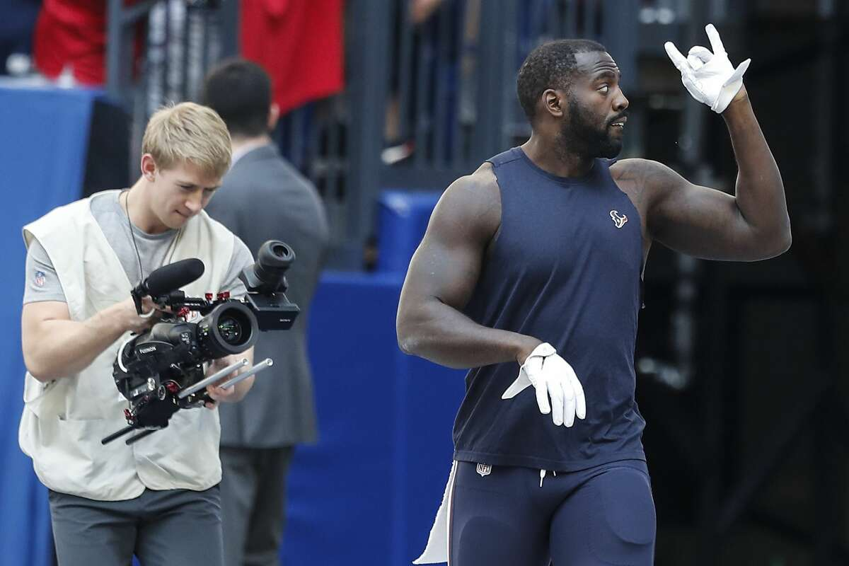 Houston Texans linebacker Whitney Mercilus waves to fans as he walks onto the field before an NFL football game against the Indianapolis Colts at Lucas Oil Stadium on Sunday, Sept. 30, 2018, in Indianapolis.