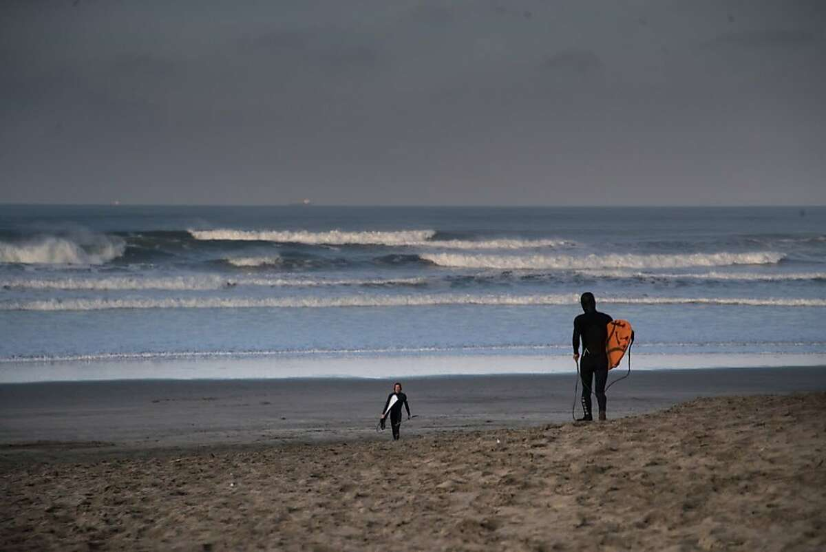Lewis Samuels didn't hear about the warning or it's cancelation and headed out to surf at Ocean Beach on Tuesday, Jan. 23, 2018 in San Francisco, CA.