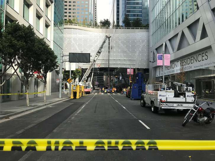 Workers at the Transbay Transit Center unload hydraulic jacks that will be used to temporarily shore up the damaged building while two cracked beams are inspected.
