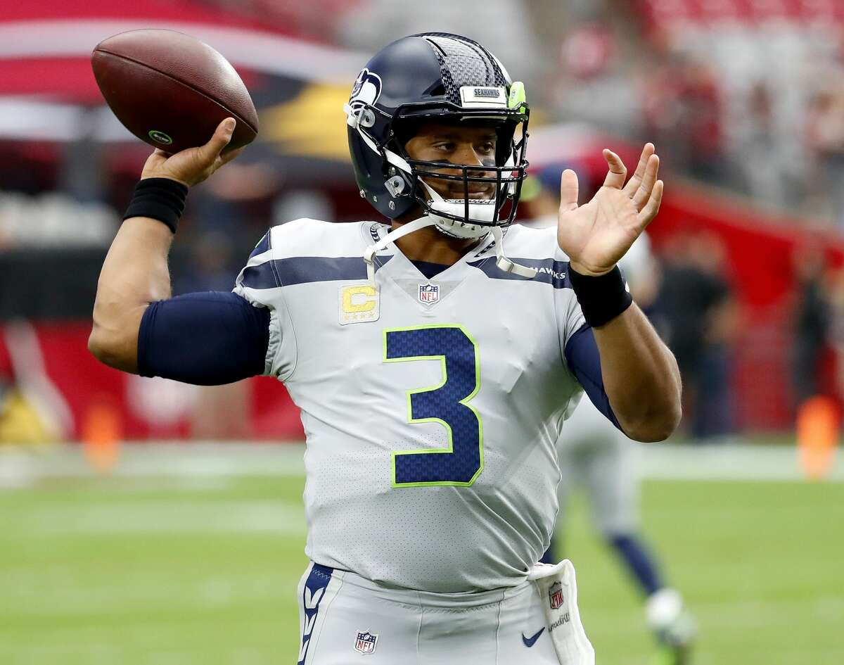 Seattle Seahawks quarterback Russell Wilson (3) warms up prior to an NFL football game against the Arizona Cardinals, Sunday, Sept. 30, 2018, in Glendale, Ariz. (AP Photo/Rick Scuteri)
