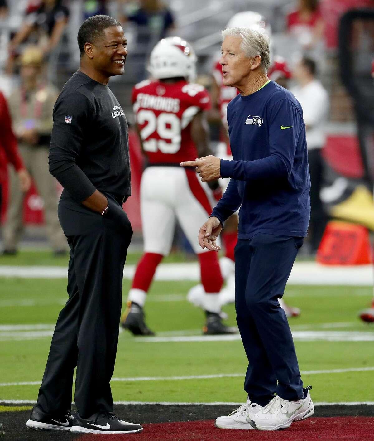 Seattle Seahawks head coach Pete Carroll, right, greets Arizona Cardinals head coach Steve Wilks prior to an NFL football game, Sunday, Sept. 30, 2018, in Glendale, Ariz. (AP Photo/Rick Scuteri)
