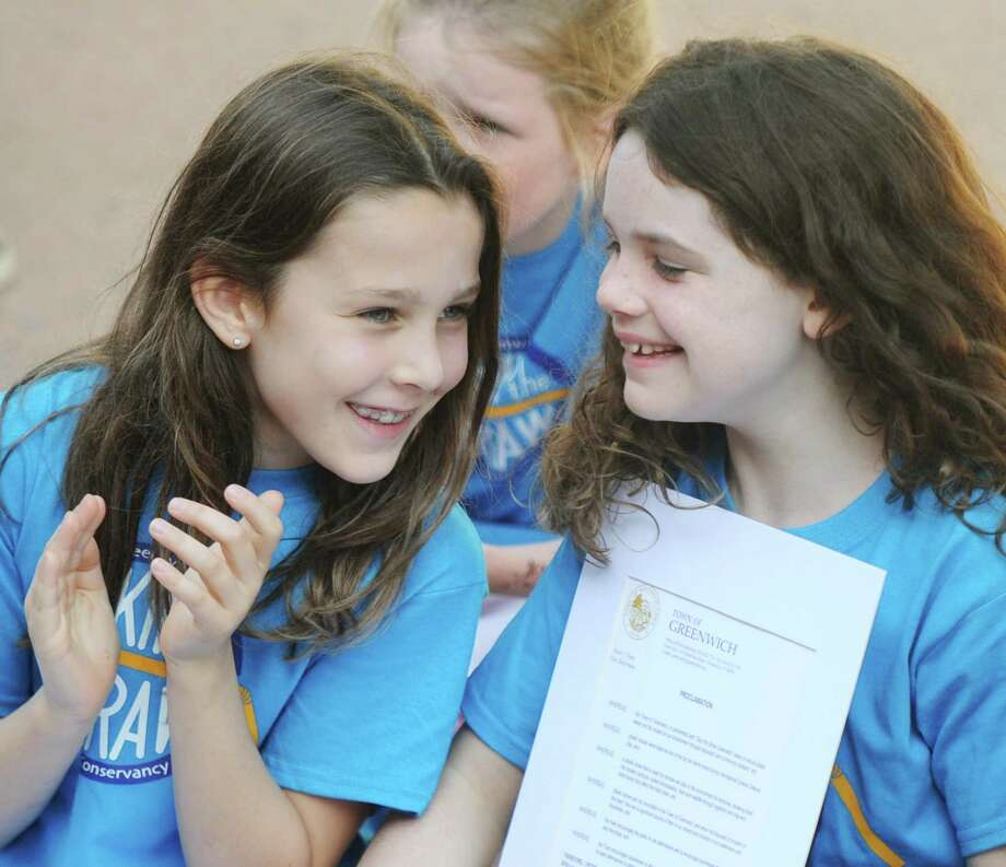 "Girl Scout Troop 50557 members Gwen Thomas, left, and Emilie Donovan hold the official ""Skip the Straw Greenwich Day"" proclamation at the Skip the Straw Greenwich Kickoff Celebration at Old Greenwich School in Old Greenwich, Conn. Sunday, Sept. 30, 2018. Skip the straw urges restaurant-goers to resist using a plastic straw as a conservation measure. The event featured conservation info booths and sustainable merchandise, words from event organizer Julie DesChamps and ambassadors of Girl Scout Troop 50557, and an official proclamation by First Selectman Peter Tesei. Photo: Tyler Sizemore / Hearst Connecticut Media / Greenwich Time"