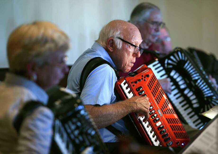 Bob Czarnecki (center) of Colchester plays in an accordion jam session conducted by Connecticut Accordion Association Orchestra conductor Peter Peluso at The Waverly Tavern in Cheshire on September 30, 2018. Photo: Arnold Gold / Hearst Connecticut Media / New Haven Register