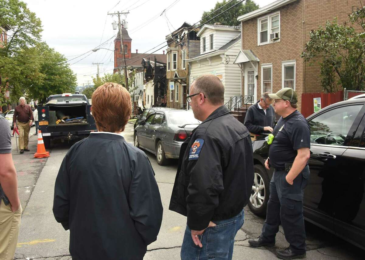 Albany Mayor Kathy Sheehan, left, talks to a code enforcement officer at the scene after a multi-home fire on Sheridan Ave. on Sunday, Sept. 30, 2018 in Albany, N.Y. (Lori Van Buren/Times Union)