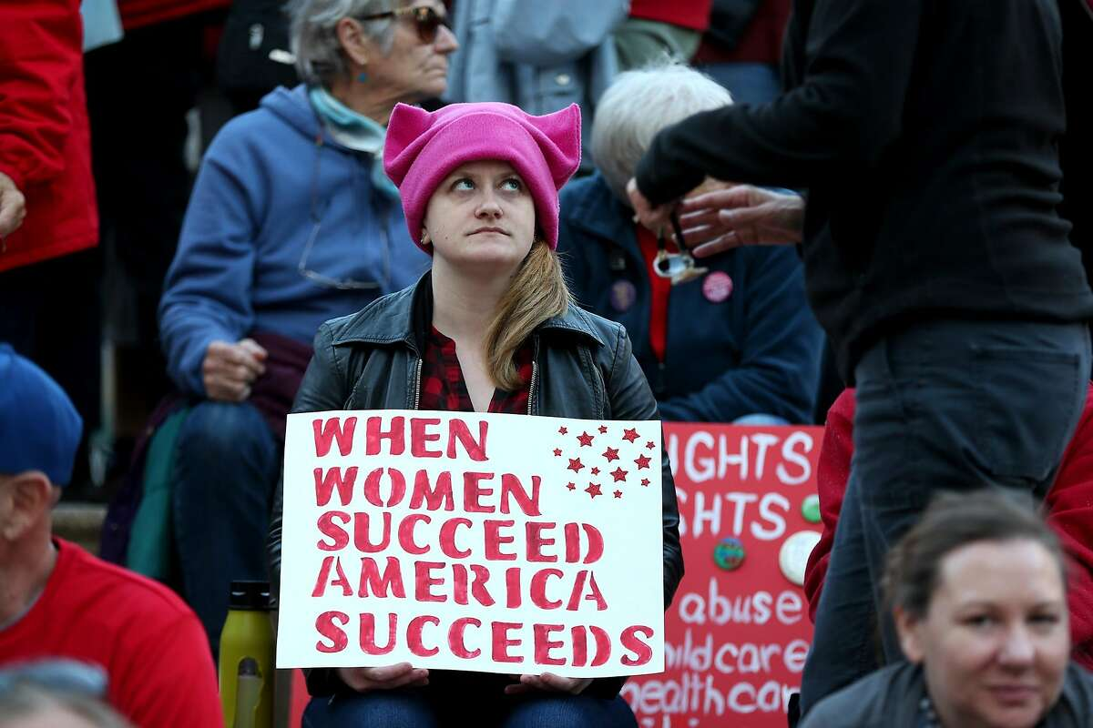 Demonstrators take part in a Day Without a Woman march and rally during the International Women's Day at Frank Ozawa Plaza in Oakland, Calif., on Wednesday, March 8, 2017. Demonstrators demand equal pay, reproductive and immigrants' rights. (Ray Chavez/Bay Area News Group/TNS)