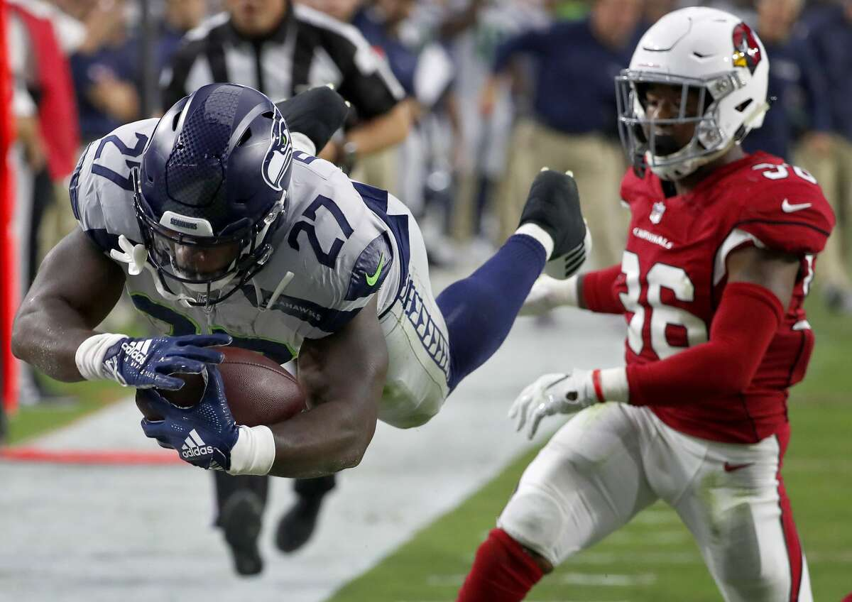 MIKE DAVIS BALLED OUT AS DE FACTO RB1 All eyes were on first-round pick Rashaad Penny with RB1 Chris Carson inactive Sunday, but Mike Davis stole the spotlight at tailback. In a surprising move, Davis got the start against the Cardinals and had 21 carries for 101 yards and two touchdowns (His first score came on a 20-yard run in the first quarter and he later completed a Seahawk scoring drive to the red zone with a one-yard TD rush). In just one game, he became the first Seahawk tailback to have multiple rushing touchdowns in a season since 2016.