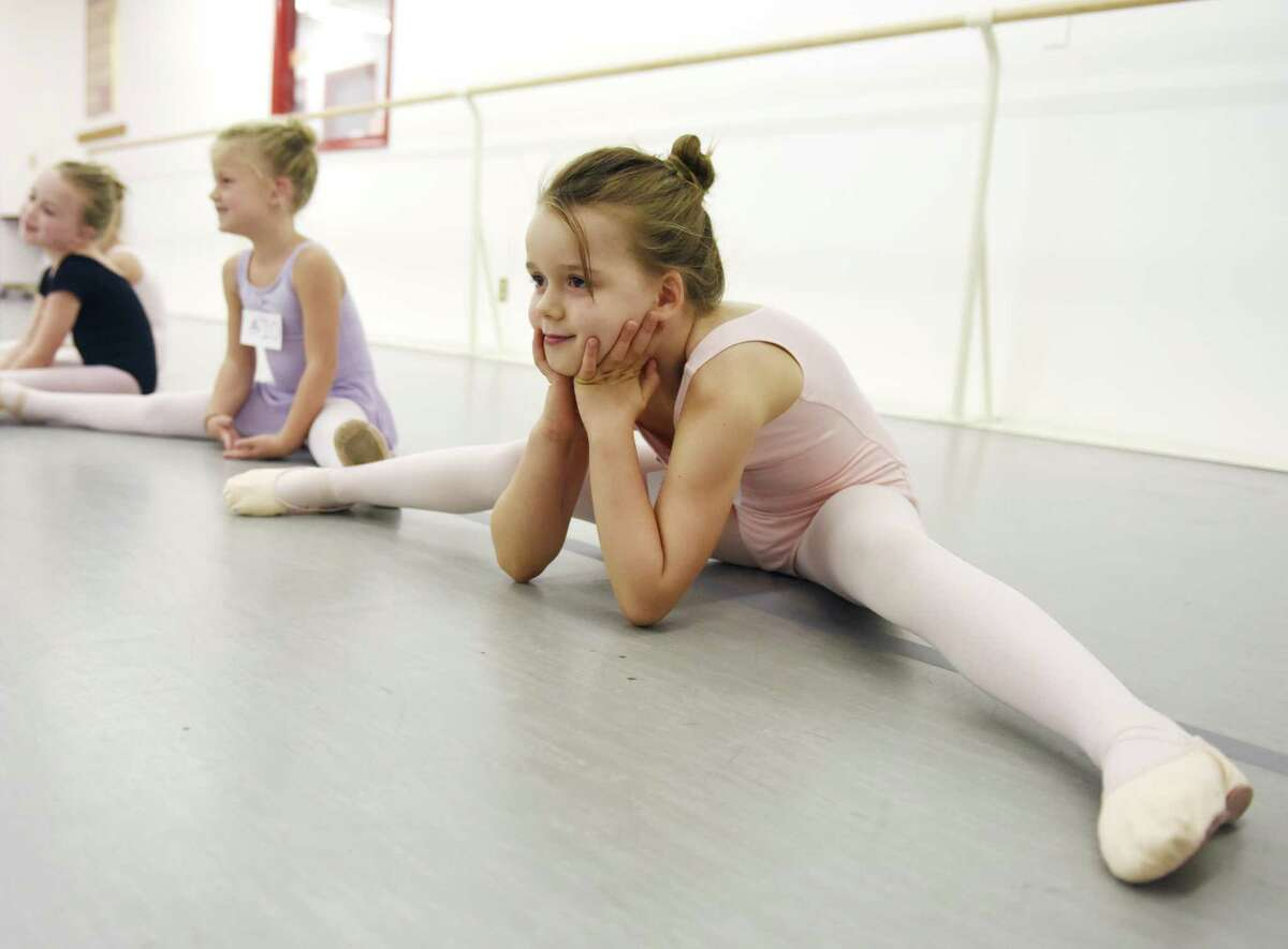 Stamford's Victoria Kiszkiel, 6, stretches out during children's auditions for